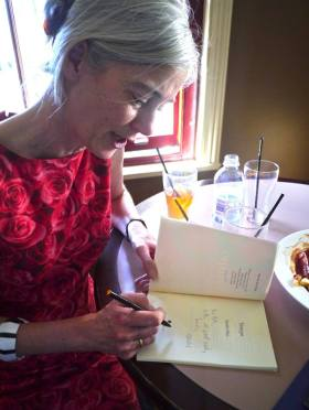 Sarah Day signs a copy of Tempo at the launch at the Friend in Hand Hotel. (Photo Robert Adamson)