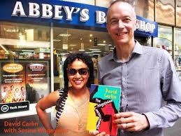 David Carlin with Sosina Wogeyehu outside Abbeys' Bookshop
