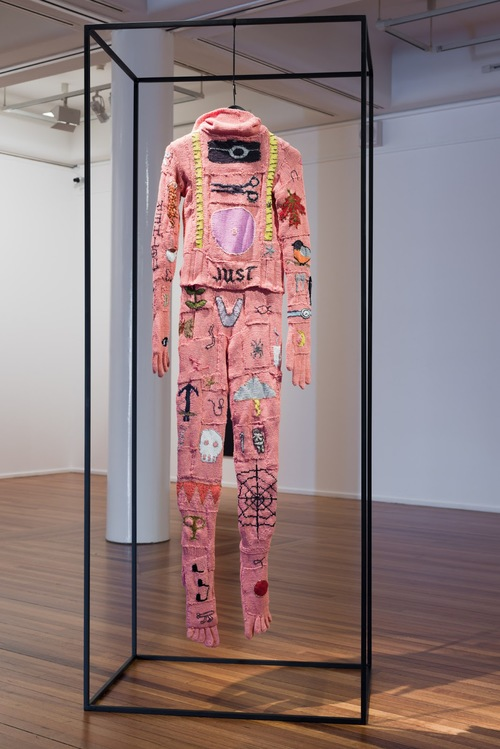 Post-script: A Burial Suit,  Kate Just 2013. right: hand knitted merino and bamboo yarn, cotton, rayon, steel Work including steel frame is 220 x 90 x 65 cm; Photo at right by Catherine Evans. Kate Just is represented by Daine Singer.