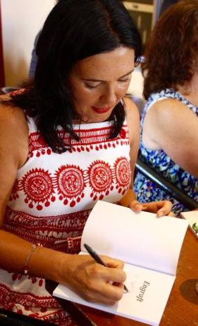 Michele Seminara signing copies of Engraft at the launch. Photograph Naida Entwistle.