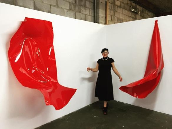 Artist Anya Pesce with her works at Factory 49. Photograph by Jim Gurieff
